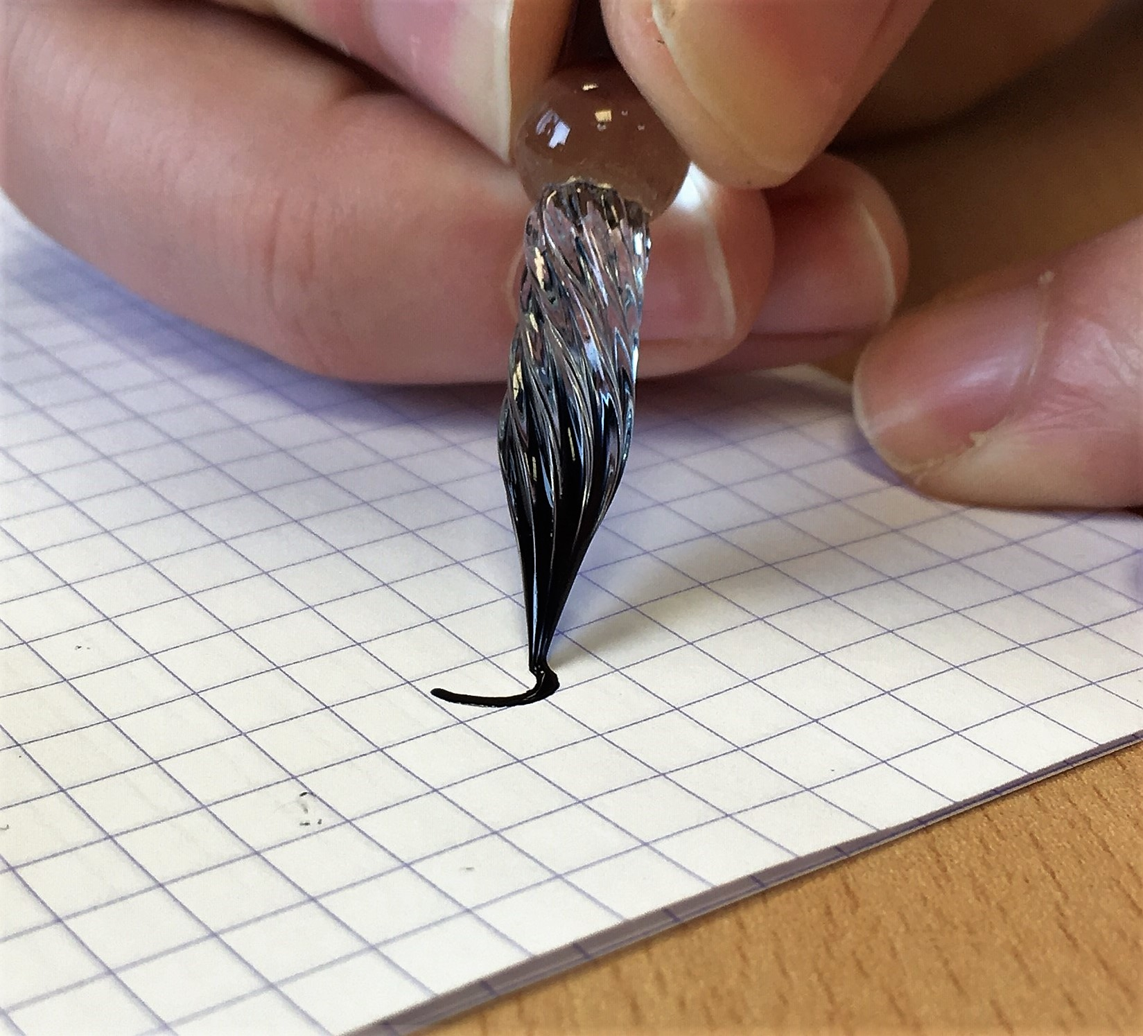 The tip of a glass dip pen