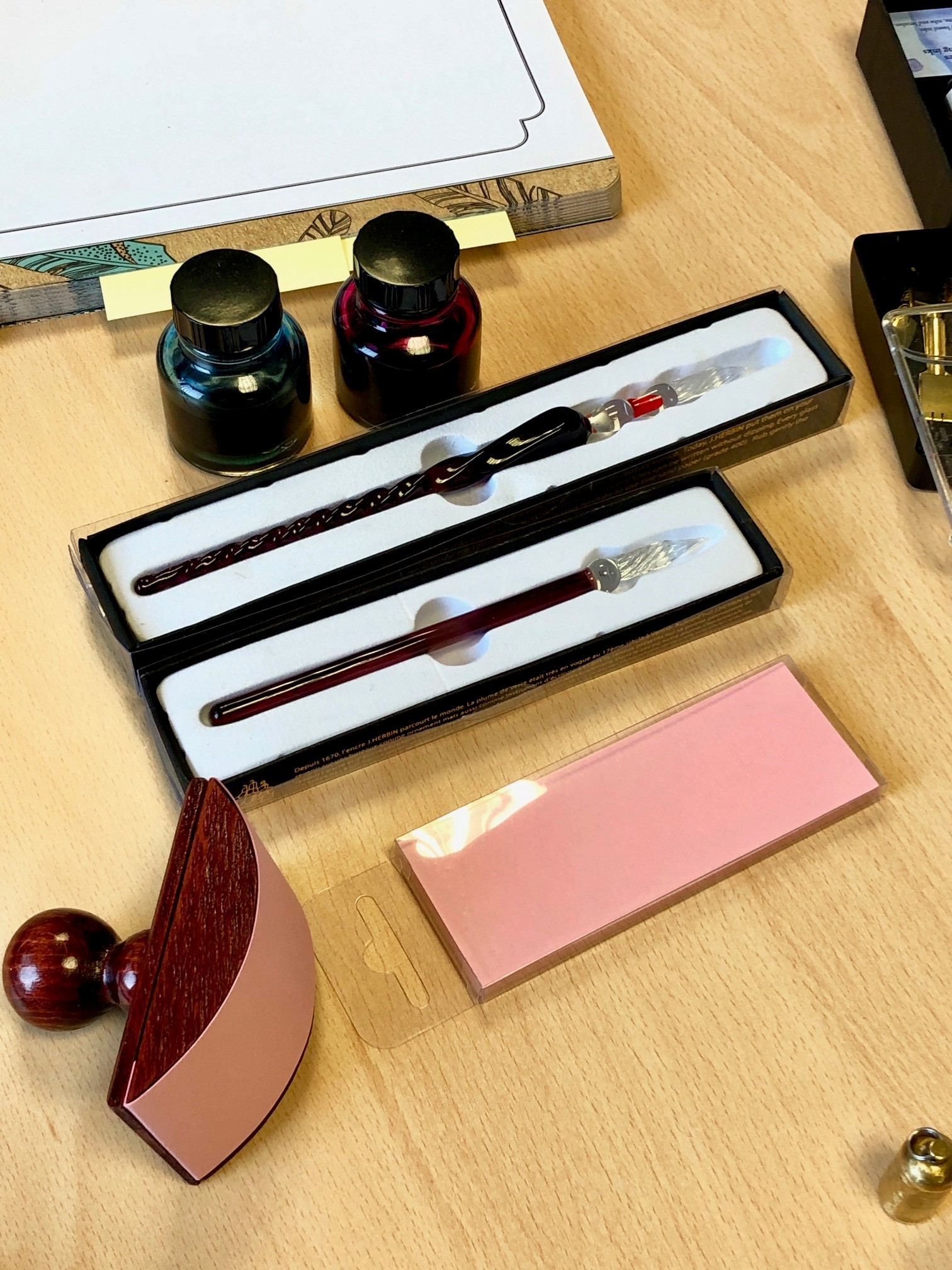 Various calligraphy supplies laid out on a desk